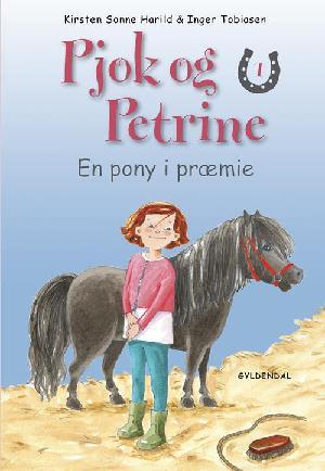 Forside til bogen En pony i præmie
